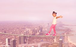 Little black girl walking over city abyss. Of Chicago background royalty free stock images