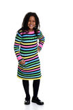 Little black girl wearing colorful dress. On white background Royalty Free Stock Image