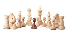 A little black pawn facing the white enemy Royalty Free Stock Photo