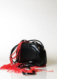 Little black purse and red jewerly Royalty Free Stock Images