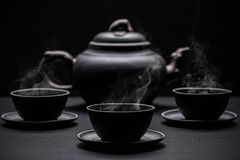 Little black tea cups royalty free stock photo
