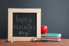 Little blackboard with inscription HAPPY TEACHER`S DAY royalty free stock photo