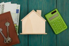 little blank house, keys, calculator, passport, money royalty free stock photo