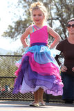 Little Blond Angel in rainbow dress at Beauty Pageant Stock Photo