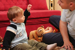 Little blond baby boy. Playing with toys at home with his father royalty free stock photos
