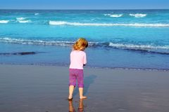 Little blond beach girl rear view sea turquoise Stock Photo