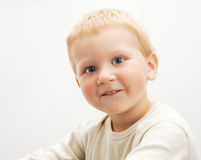 Little blond boy Stock Images