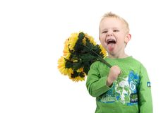 Little blond boy. With flowers in his hands smiling Royalty Free Stock Images