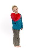 Little blond boy. With heart day dreaming Stock Photography