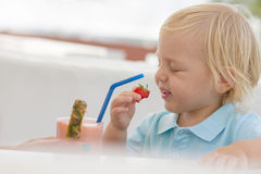 Little blond boy in a cafe Royalty Free Stock Photo