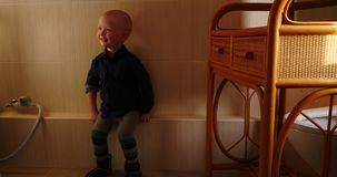 Little blond boy dancing in the bathroom next to the washing machine.  stock video
