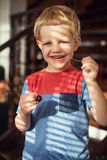 Little blond boy eating sweet cherries. Outdoor portrait Royalty Free Stock Images