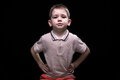 Little blond boy with hands on hips Royalty Free Stock Image