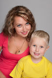 Little blond boy and his mother Stock Images