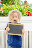 Little blond boy holding school blackboard Stock Photography