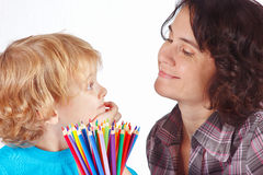 Little blond boy and mother with color pencils Royalty Free Stock Images