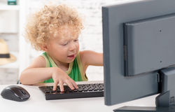 A little blond boy playing with the keyboard Royalty Free Stock Photos