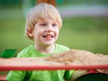 Little blond boy playing on playground Stock Photography