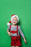 Little blond boy with Santa Claus cap smiling Stock Photo