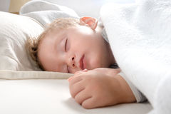 Little blond boy sleeping on his bed relaxed Stock Photo