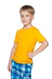 Little blond boy in a yellow shirt Stock Photos