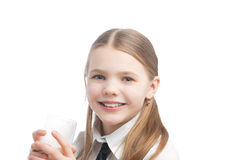 Little blond caucasian girl drinking milk Royalty Free Stock Photo