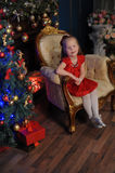 Little blond child in a red dress Royalty Free Stock Image