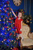 Little blond child in a red dress Royalty Free Stock Photo