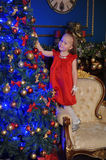Little blond child in a red dress Royalty Free Stock Images