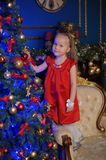 Little blond child in a red dress Stock Photo