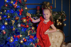 Little blond child in a red dress Stock Image
