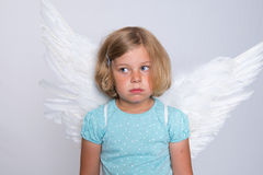 Little blond girl with angel- wings Stock Photos