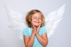 Little blond girl with angel- wings Stock Photo