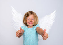 Little blond girl with angel- wings Stock Image
