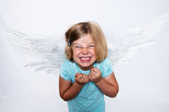 Little blond girl with angel- wings Royalty Free Stock Photography