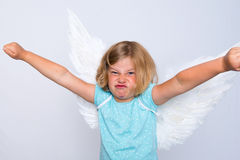 Little blond girl with angel- wings Stock Images