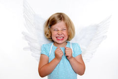 Little blond girl with angel- wings. Wild blond girl with angel- wings in front of white background Stock Photography