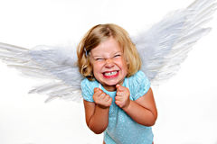 Little blond girl with angel- wings. Wild blond girl with angel- wings in front of white background Royalty Free Stock Image