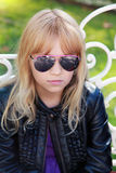 Little blond girl in black sunglasses Stock Photography