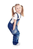 Little blond girl in blue overalls Royalty Free Stock Image