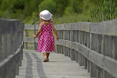 Little blond girl on boardwalk Royalty Free Stock Photo