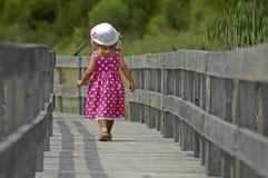 Little blond girl on boardwalk royalty free stock photo