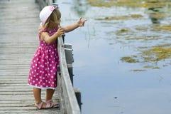 Little blond girl on boardwalk Stock Photos
