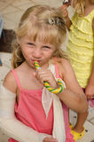 Little blond girl with broken hand Royalty Free Stock Image