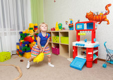 Little blond girl dancing like cheerleader in daycare Royalty Free Stock Image