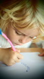 Little blond girl drawing Stock Photography