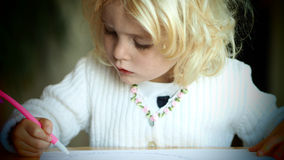 Little blond girl drawing Royalty Free Stock Photos
