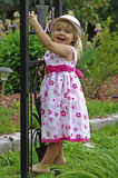 Little blond girl in the garden Stock Photos