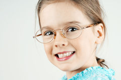 Little blond girl with glasses Stock Photo