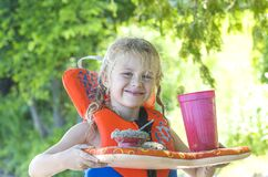 Little blond girl with handmade beach lunch